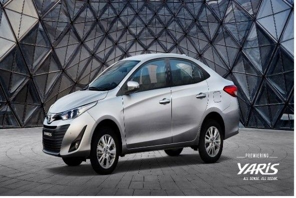 Silver Color Toyota Yaris Parked Outside Glass Dome