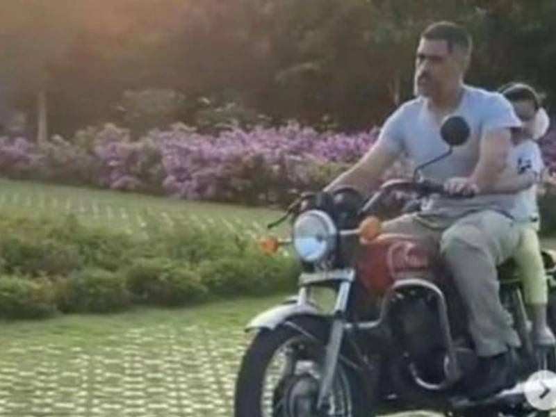 MS Dhoni Rides Yamaha RD 350 with Daughter Ziva