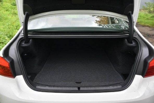 Space-saver tyre is tucked under the boot floor.