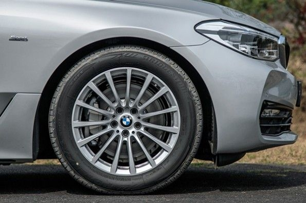 Multi-spoke alloy wheels look small.