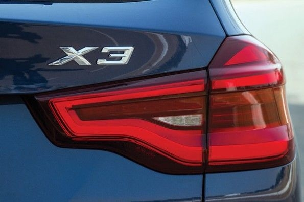 The tailight has sculpted edges.
