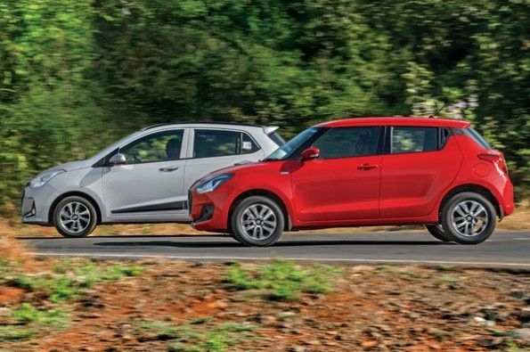 The all-new Swift takes on its biggest rival.