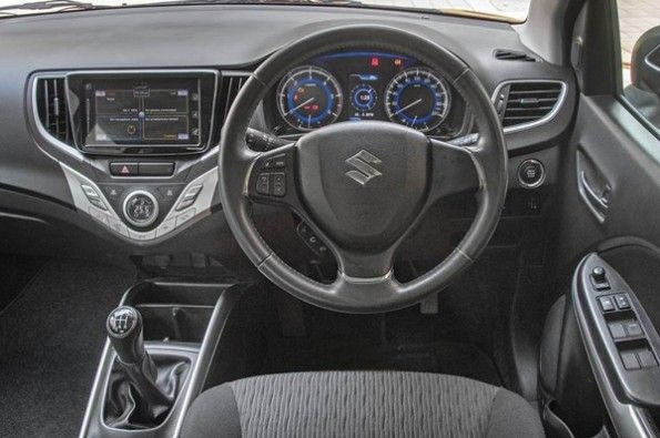 The all-black interior in the Baleno looks sporty.