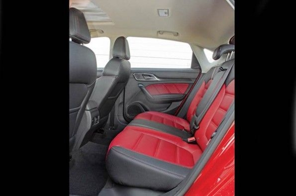 The red and black interior looks sporty.