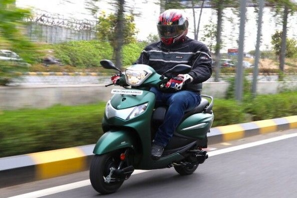 Green Color Hero Pleasure Plus Front Profile With Rider